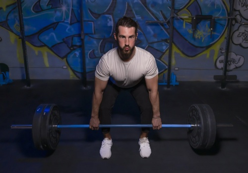 Lithium8 is the first battery-powered Thumper and the only percussive massager of its kind. Model starts to perform a deadlift.